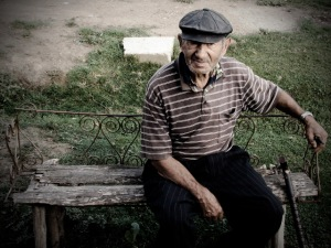 An old man sitting on a bench