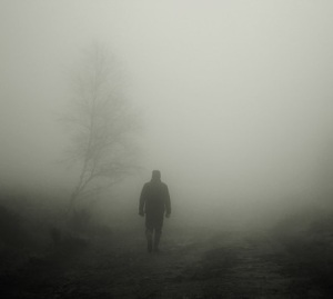 man in a fog, walking away